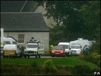 Police at Colin McRae's home