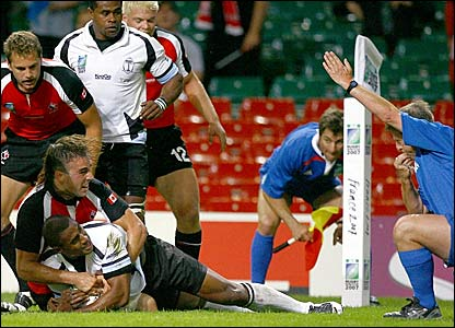 The referee awards a try to Fiji after Kamelu Ratuvou squeezes over