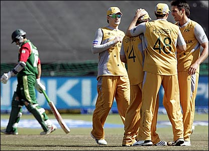 Nazimuddin trudges off while Australia players celebrate his wicket