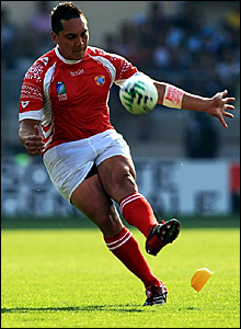 Pierre Hola kicks a penalty for Tonga