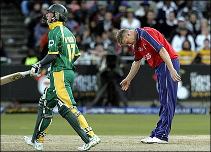 Andrew Flintoff (right) shows AB de Villiers the way after having him caught behind for 18