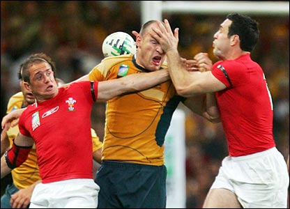 Wales' Shane Williams and Stephen Jones challenge Stirling Mortlock