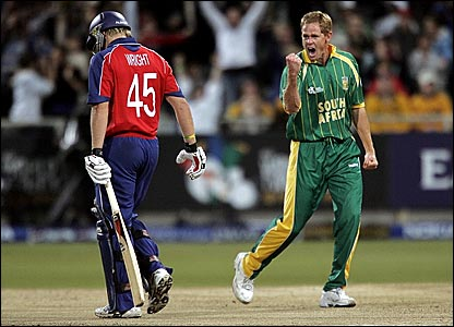 England's Luke Wright (left) departs to the delight of Shaun Pollock