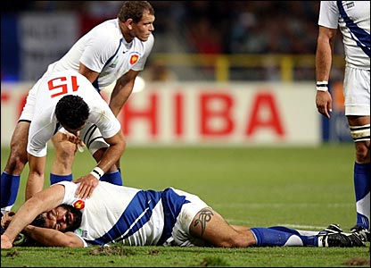Sebastien Chabal lies on the ground after being felled by a high tackle