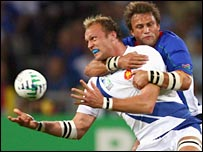 France number eight Julien Bonnaire is tackled by Namibia's Piet van Zyl