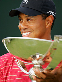 Tiger Woods with his latest trophy
