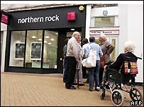 Customers queue to enter a Northern Rock branch in Chelmsford in Essex earlier in September