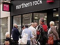 Customers queue to enter a Northern Rock branch in Chelmsford in Essex on Monday