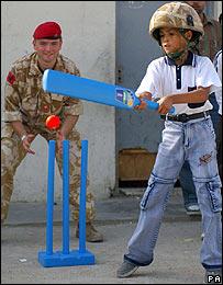Iraqi boy plays cricket