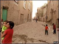 Children play in run-down street in Old Kabul, 5 September 2007