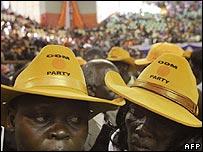 Two women wearing yellow ODM hats