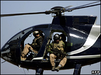 Blackwater security personnel on board a helicopter in Baghdad (2005)