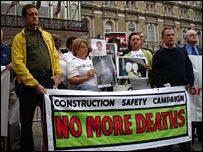 Vigil outside building site talks
