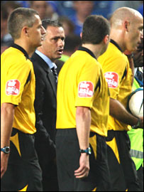 Jose Mourinho with officials after the Blackburn game