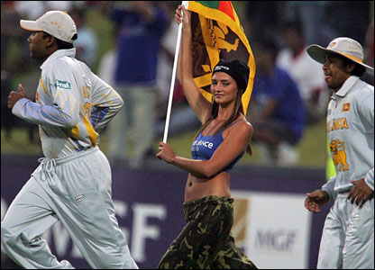 A cheerleader waves a Sri Lanka flag as the players run out