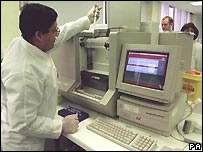 A scientist working with a sample on the UK DNA Database