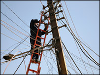 Engineer working on a mass of electric power lines