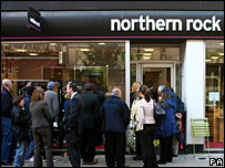 Customers queue to enter a Northern Rock branch in south west London