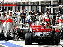 Fernando Alonso holds up Lewis Hamilton in the pits during qualifying in Hungary