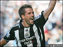 Michael Owen celebrates a goal in his Northern Rock-sponsored Newcastle shirt