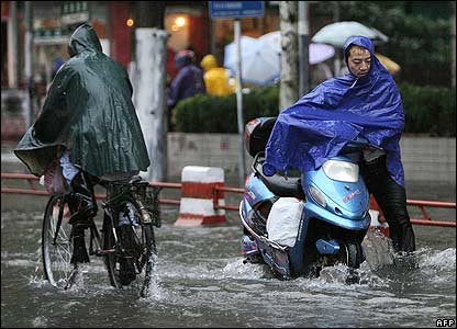 Pedestrians and motorists during a rain storm in Shanghai