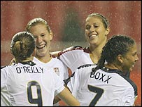 USA's Lori Chalupny (second left) celebrates her goal against Nigeria