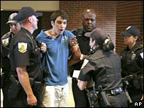 University of Florida student Andrew Meyer is restrained by campus police officers