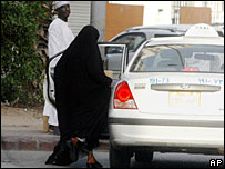 A woman gets in a taxi in Jeddah, Saudi Arabia
