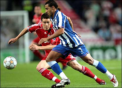 Liverpool's Steve Finnan and Ricardo Quaresma of FC Porto tangle early on