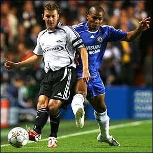 Roar Strand of Rosenborg (L) battles with Chelsea's Florent Malouda