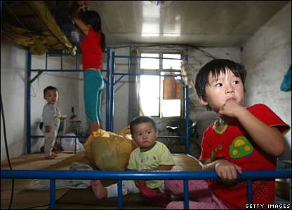 Children sit in a disaster shelter waiting for Typhoon Wipha in Yueqing of Zhejiang Province