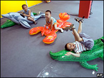 Young Chinese boys play at a Beijing fair (file image)