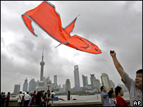 A Chinese man flies a kite on the Bund in Shanghai