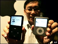 Man with two iPods
