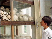 Boy looking at the skulls of Khmer Rouge victims at a memorial outside Phnom Penh