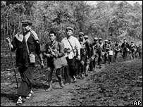 Khmer Rouge leader Pol leads a column of his men, in this photo obtained in 1979 by Japan's Kyodo News service. 