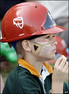 A young South Africa fan in a red helmet