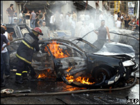 A car set alight by the explosion in Beirut (19 September 2007)