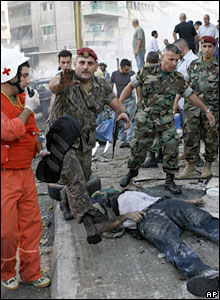 The body of a dead man is seen at the scene of the Beirut bombing