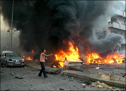 Burning cars are seen at the site of the Beirut car bombing