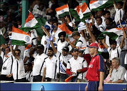 Indian fans wave their national flags