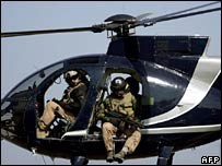 Blackwater employees scan Baghdad from their helicopter. File photo