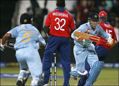 Virender Sehwag and Gautam Gambhir run a quick single past Dimitri Mascarenhas