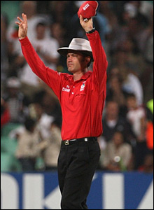 Umpire Simon Taufel signals one of Yuvraj's six sixes