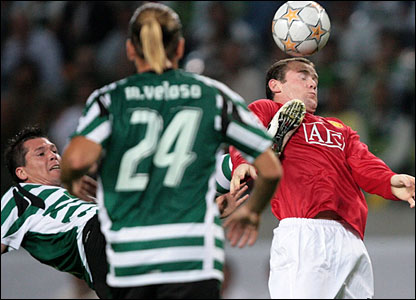 Anderson Polga challenges Wayne Rooney