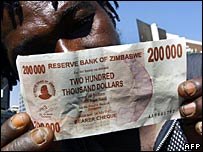 A man holds a Zimbabwean $200,000 note