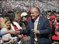 Rudy Giuliani greets the crowd at the Sylvania Nascar 300 on 16 September