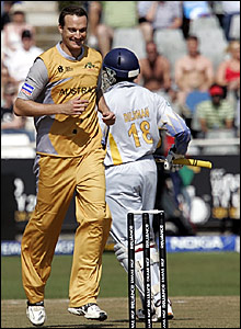Stuart Clark (left) celebrates the dismissal of Tillakaratne Dilshan