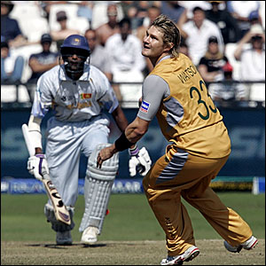 Jehan Mubarak (left) hits out off Shane Watson