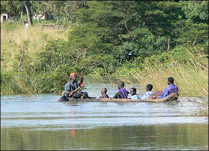 People in a dugout canoe on River Moroto [Pic: Hudson Apunyo]